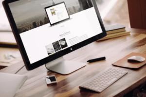 Apple iMac on a Wooden Desk