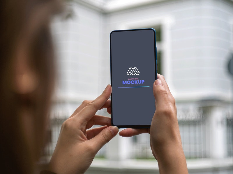 Free Holding Smartphone Mockup