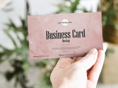 Free Holding Business Card PSD Mockup